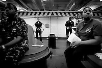Members of the crew take part in a Gospel religious service in the anchor room aboard the USS Dwight D. Eisenhower (CVN 69), a nuclear powered american aircraft carrier that is currently supporting Operation Enduring Freedom, the american effort in Afghanistan, by sending tens of its jets every day to support ground troops in air to ground bombing operations, on Sunday May 31 2009 at an undisclosed location in the Arabian Sea. .Aboard the ship there are three religious services every sunday, the gospel one being the most popular. Three chaplains serve the more than 5000 crew that serve aboard the Eisenhower.