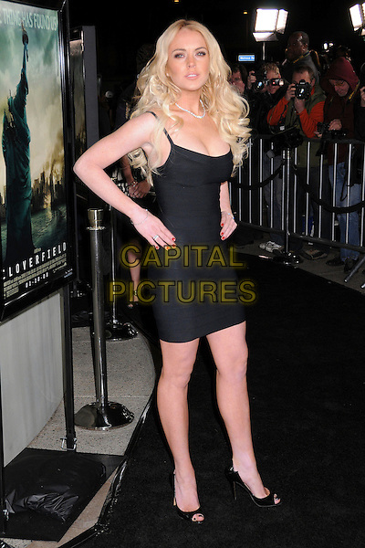 """LINDSAY LOHAN.""""Cloverfield"""" Los Angeles Premiere at Paramount Studios, Hollywood, California, USA..January 16th, 2008 .full length black dress hands on hips .CAP/ADM/BP.©Byron Purvis/AdMedia/Capital Pictures."""
