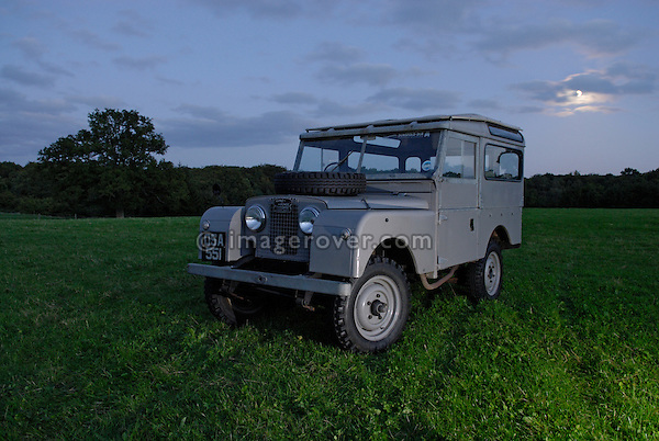 Very original historic 1950s Landrover Series 1 88in Station Wagon of the Dunsfold Collection on a moonlit field in Surrey, south England. Europe, UK, England, Surrey, Dunsfold. ---No releases available.  Automotive trademarks are the property of the trademark holder, authorization may be needed for some uses. --- Information: Land Rover Series 1 88in Station Wagon belonging to the Dunsfold Collection; chassis number 111800622, registration number OSA 551, engine type 2.0 litre petrol, gearbox type 4 speed. Vehicle specification: This 1950s Sereis 1 Station Wagon has only covered 26,000 miles from new. The paint is all original, apart from the road wheels and front grill. The vehicle has spent its whole life on a private estate in Scotland, where it obviously led a very quiet life. It is slightly unusual in that the paint is early export grey. Vehicles of this age should be later dove grey.