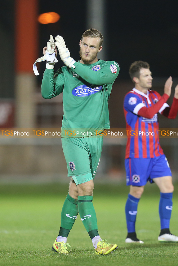 Liam O'Brien of Dagenham  applauds the fans at the end of the game Dagenham and Redbridge vs Notts County, Sky Bet League 2 Football at the Chigwell Construction Stadium, London, England on 29/09/2015