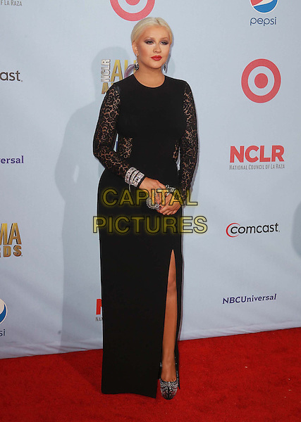 Christina Aguilera.2012 NCLR ALMA Awards - arrivals, held at The Pasadena Civic Auditorium, Pasadena, California USA..16th September 2012.full length black lace dress silver clutch bag red slit split  shoes.CAP/ADM/KB.©Kevan Brooks/AdMedia/Capital Pictures.