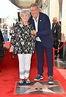 LOS ANGELES, CA. July 24, 2019: Kenny Ortega & Madeline Ortega at the Hollywood Walk of Fame Star Ceremony honoring Kenny Ortega.<br /> Pictures: Paul Smith/Featureflash