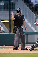 Home plate umpire Jonathan Bailey makes a strike call during the International League game between the Gwinnett Braves and the Charlotte Knights at BB&T BallPark on August 11, 2015 in Charlotte, North Carolina.  The Knights defeated the Braves 3-2.  (Brian Westerholt/Four Seam Images)