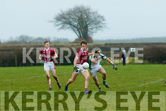 James Garvey, Ballybrown, looks to stop Donnachadh Walsh, Cromane, during their sides clash with Ballybrown in the Munster Junior B Club Football Final in Knockaderry