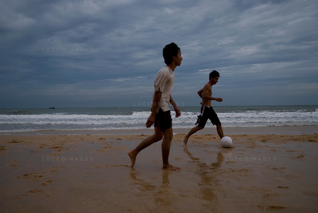 Vietnamese boys play soccer on the beach in Mui Ne, Vietnam.