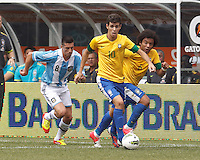 Brazil midfielder Oscar (10) brings the ball forward as Argentina midfielder Jose Sosa (8) closes. Brazil defender Marcelo (6). In an international friendly (Clash of Titans), Argentina defeated Brazil, 4-3, at MetLife Stadium on June 9, 2012.