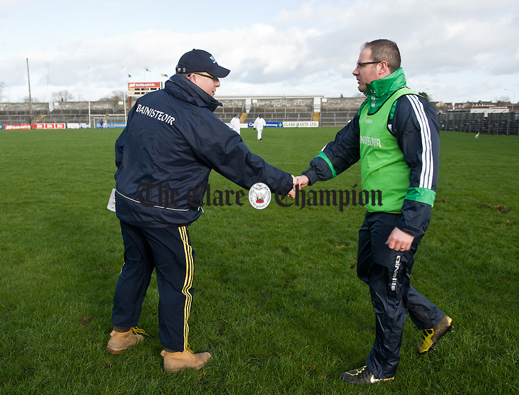 Clare manager Micheal Mc Dermott meets with defeated opposition manager Maurice Honan following their National League win over Limerick at Cusack Park. Photograph by John Kelly.