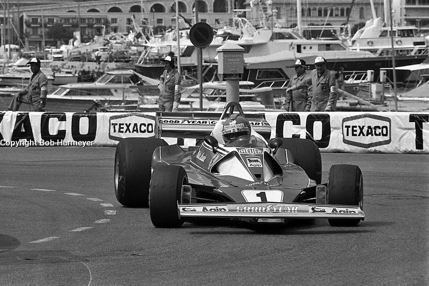 MONTE CARLO, MONACO - MAY 30: Niki Lauda of Austria drives the Ferrari 312T2 026/Ferrari 015 en route to victory in the Grand Prix of Monaco FIA Formula 1 race at the Circuit de Monaco temporary street circuit in Monte Carlo, Monaco on May 30, 1976.