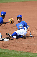 Domenic DeRenzo (16) of Central Catholic High School in Pittsburgh, Pennsylvania playing for the Chicago Cubs scout team slides into third as Jamarius Smith (20) waits for a throw during the East Coast Pro Showcase on July 31, 2014 at NBT Bank Stadium in Syracuse, New York.  (Mike Janes/Four Seam Images)
