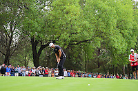 Dustin Johnson (USA) sinks his putt on 16 after having his second shot get stuck in a tree during round 3 of the World Golf Championships, Mexico, Club De Golf Chapultepec, Mexico City, Mexico. 3/4/2017.<br /> Picture: Golffile | Ken Murray<br /> <br /> <br /> All photo usage must carry mandatory copyright credit (&copy; Golffile | Ken Murray)