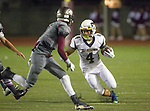 Torrance, CA 09/25/15 - Taz Tauaese (El Segundo #4) and Jerome Duhon (Torrance #1) in action during the El Segundo - Torrance varsity football game at Zamperini Field of Torrance High School