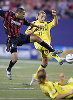 The MetroStars' Ricardo Clark battles the Crew's Danny Szetela for the ball. The Columbus Crew and the MetroStars played to a 1-1 tie in regular season MLS action on Saturday October 9, 2004 at Giant's Stadium, East Rutherford, NJ..