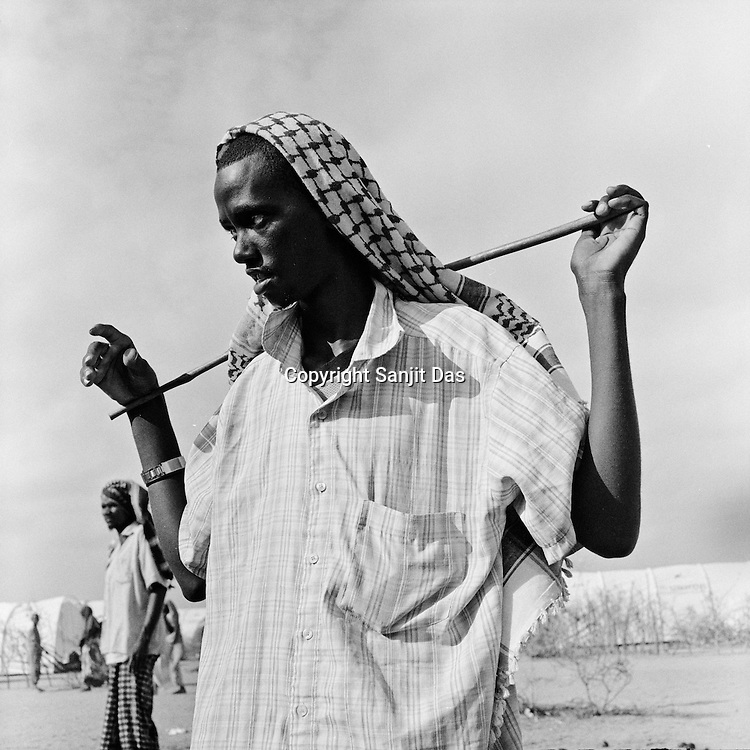 A Somali refugee seen at the Dagahaley camp in the Dadaab refugee camp in northeastern Kenya. Hundreds of thousands of refugees are fleeing lands in Somalia due to severe drought and arriving in what has become the world's largest refugee camp. Photo: Sanjit Das/Panos