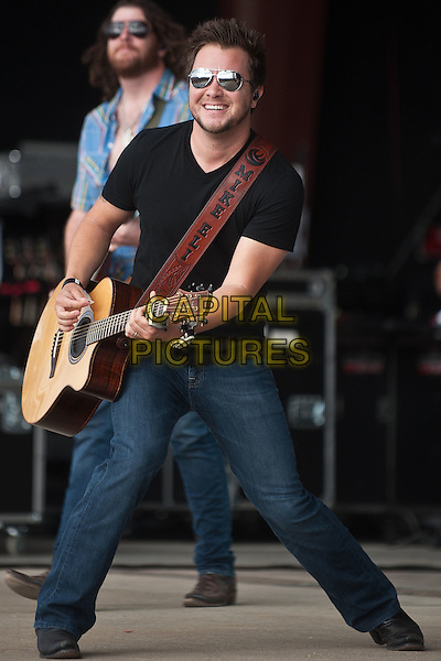 Mike Eli of Eli Young Band.Eli Young Band performs during the 2012 Jamboree In The Hills,  Morristown, Ohio, USA, 21st July 2012..country music live on stage concert gig .full length playing guitar sunglasses black t-shirt jeans .CAP/ADM/RP.©Ryan Pavlov/AdMedia/Capital Pictures.