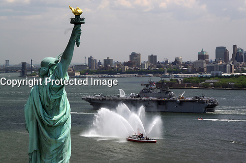 The amphibious assault ship USS Kearsarge (LHD 3) passes by the Statue of Liberty as it steams up the Hudson River in New York during the Parade of Ships for Fleet Week New York 2008 May 21, 2008. More than 4,000 Sailors, Marines, and Coast Guardsmen will participate in various community relations projects and make a port call to New York City. (U.S. Navy photo by Mass Communication Specialist 3rd Class David Danals/Released)