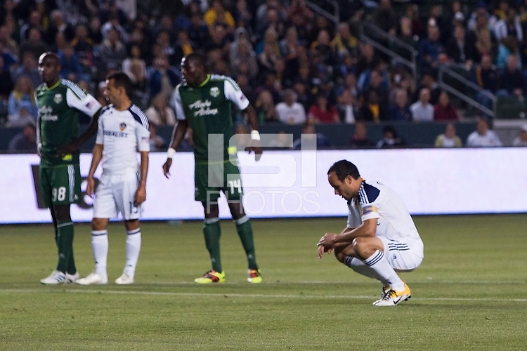 LA Galaxy captain Landon Donovan (10) contemplates his PK. The LA Galaxy defeated the Portland Timbers 3-0 at Home Depot Center stadium in Carson, California on  April  23, 2011....