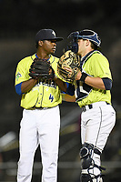 Pitcher Ezequiel Zabaleta (4) of the Columbia Fireflies talks with catcher Hayden Senger in a game against the Charleston RiverDogs on Saturday, April 6, 2019, at Segra Park in Columbia, South Carolina. Columbia won, 3-2. (Tom Priddy/Four Seam Images)