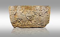 Picture &amp; image of Hittite monumental relief sculpted orthostat stone panel from Water Gate Limestone, Karkamıs, (Kargamıs), Carchemish (Karkemish), 900-700 BC.  Anatolian Civilisations Museum, Ankara, Turkey.<br /> <br /> The figure sitting on a stool to the left of the table holds a goblet in his right hand which he raised upwards. Behind, there is a servant with a fan in his hand. On the other side of the table is another servant waits with a vessel in the hands. The rightmost figure plays a Saz (a stringed musical instrument) with the tassel on the handle. <br /> <br /> On a gray background.