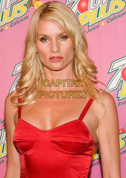 NICOLLETTE SHERIDAN.Actresses Marcia Cross & Nicollette Sheridan Co-Host Exclusive Premiere Party for New 7 Up Plus Commercial held at the Cabana Club.  .USA, United States.23rd August 2005.Ref:ADM/ZL.half length red strappy top fitted bra pert breasts boobs eye contact posed.www.capitalpictures.com.sales@capitalpictures.com.©Zach Lipp/AdMedia/Capital Pictures