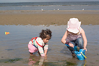 Morgan and Safina playing in shallow water, Bettystown beach near Drogheda 2nd Aug 2007