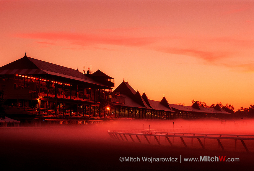 ©Mitch Wojnarowicz Photographer.Saratoga Springs NY Sunrise, the club house and morning fog during morning workouts at sunrise at the thoroughbred horse racing track here..20030823.Not a royalty free image. COPYRIGHT PROTECTED.www.mitchw.com.www.mitchwblog.com.518 843 0414_Mitchw@nycap.rr.com.ANY USE REQUIRES A WRITTEN LICENSE.NO Model release for this image
