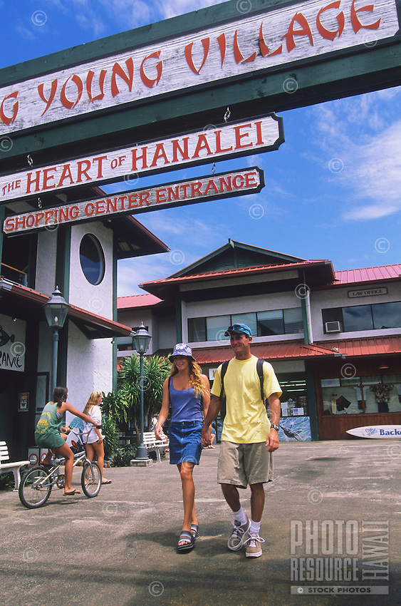 Couple strolling through Ching Young Village Shopping Center in Hanalei, Kaua'i.