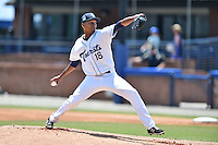 Asheville Tourists starting pitcher Carlos Polanco (18) delivers a pitch during a game against the Rome Braves on July 26, 2015 in Asheville, North Carolina. The Tourists defeated the Braves 16-4. (Tony Farlow/Four Seam Images)