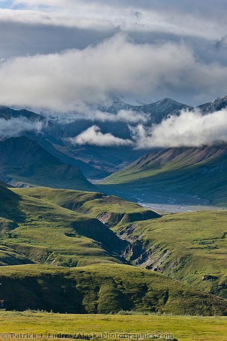 Clouds over the Alaska Range mountains and gorge creek, Denali National Park, Interior, Alaska.