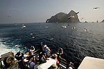 Tourists take photos of the Dokdo Islands, known to Japanese as Takeshima, sovereignty over which is disputed between Japan and South Korea, in the Sea of Japan on 22 June 2010..Photographer: Robert Gilhooly.Tourists take photos of the Dokdo Islands, known to Japanese as Takeshima, sovereignty over which is disputed between Japan and South Korea, in the Sea of Japan on 22 June 2010..Photographer: Robert Gilhooly.