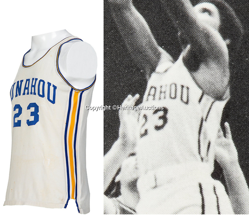 BNPS.co.uk (01202 558833)<br /> Pic: HeritageAuctions/BNPS<br /> <br /> 'Barry' Obama playing fo Punahou in the vest.<br /> <br /> Barack Obama's high school basketball top has emerged for sale for £80,000. ($100,000)<br /> <br /> The former president was a callow 18 year old when he wore the white number 23 jersey for Punahou School in Hawaii 40 years ago.<br /> <br /> His love of the sport endured into adulthood and he was frequently seen playing it at the White House.<br /> <br /> The top was due to be discarded at the end of the 1978/79 season, but his team-mate Peter Noble decided to take it home as he had also worn it when Obama was not able to play.<br /> <br /> He kept hold of it as a souvenir as they had become state champions. Now, four decades later, he is selling it with Heritage Auctions, of Dallas, Texas.