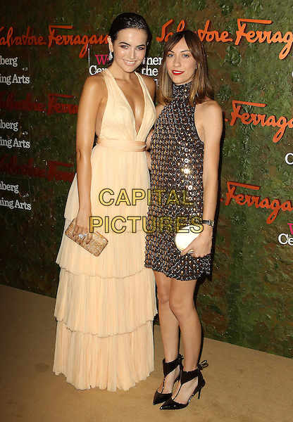 Freida Pinto, Gia Coppola<br /> Wallis Annenberg Center For The Performing Arts Inaugural Gala held at Wallis Annenberg Center For The Performing Arts,  Beverly Hills, California, USA, 17th October 2013.<br /> full length beige cream long maxi dress tiered nude low cut layered gold jewelled embellished <br /> CAP/ADM/KB<br /> &copy;Kevan Brooks/AdMedia/Capital Pictures