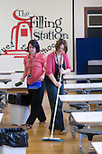 Dinner Ladies cleaning up after lunch,  State Secondary Roman Catholic school.