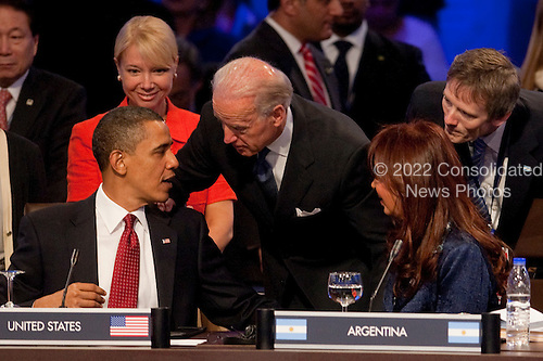 United States President Barack Obama speaks to U.S. Vice President Joseph Biden, center, and President Cristina Fernandez de Kirchner of Argentina right, during the opening plenary session with the heads of delegations attending the Nuclear Security Summit at the Washington Convention Center in Washington, D.C., U.S., on Tuesday, April 13, 2010. Ukraine's agreement to relinquish its entire stockpile of highly enriched uranium gave Obama the first concrete result for a summit he convened on securing the world's atomic material. .Credit: Andrew Harrer / Pool via CNP