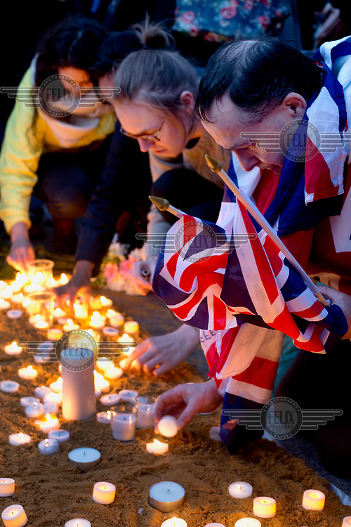 People light candles at a vigil in Trafalgar Square for victims of 22 March 2017 Westminster terror attack.