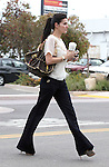 4-11-09 Exclusive.Angie Harmon walking with a Louis Vuitton purse and a big gold watch getting coffee in Malibu ca.  Angie's big High heels made her paints look like bell bottoms ..AbilityFilms@yahoo.com.805-427-3519.www.AbilityFilms.com