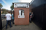 Supporters paying for their admission at a turnstile at the Mersey Travel Arena, home to Marine Football Club, pictured before they played host to Ilkeston FC in a Northern Premier League premier division match. The match was won by the home side by 3 goals to 1 and was watched by a crowd of 398. Marine are baed in Crosby, Merseyside and have played at Rossett Park (now the Mersey Travel Arena)  since 1903, the club having been formed in 1894.