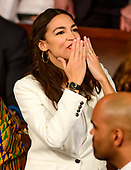 United States Representative Alexandria Ocasio-Cortez (Democrat of New York) blows a kiss to someone in the gallery as the 116th Congress convenes for its opening session in the US House Chamber of the US Capitol in Washington, DC on Thursday, January 3, 2019.<br /> Credit: Ron Sachs / CNP<br /> (RESTRICTION: NO New York or New Jersey Newspapers or newspapers within a 75 mile radius of New York City)