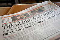 A Globe and Mail newspaper lie on table in Toronto April 23, 2010. The Globe and Mail is a Canadian English language nationally distributed newspaper, based in Toronto and printed in six cities across the country with a weekly readership of 935 000.