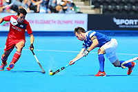 Scotlands captain Chris Grassick competes with Junwoo Jeong of Korea during the Hockey World League 9th and 10th placing match between Korea and Scotland at the Olympic Park, London, England on 22 June 2017. Photo by Steve McCarthy.