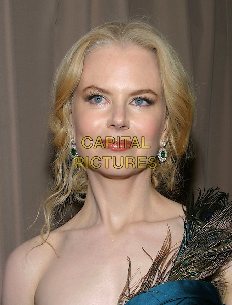 NICOLE KIDMAN.Miramax , Coors Light, AMC & Glamour Magazine present the 2005 Golden Globes After-Party held Trader Vic's in the Beverly Hilton Hotel, Beverly Hills, California .Photo Credit: Jacqui Won/AdMedia..January 16th, 2005.headshot, portrait peacock feathers, emerald drop earrings.www.capitalpictures.com.sales@capitalpictures.com.© Capital Pictures.
