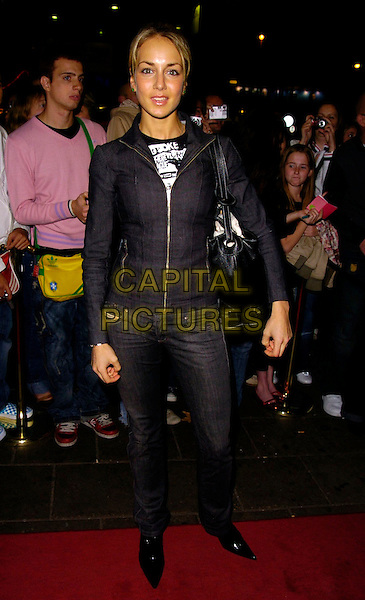 LADY ISABELLA HERVEY.The Sugababes new album launch & concert at the Dominion Thatre, London, UK..October 29th, 2006.Ref: CAN.full length jeans denim jacket purse bag black.www.capitalpictures.com.sales@capitalpictures.com.©Can Nguyen/Capital Pictures