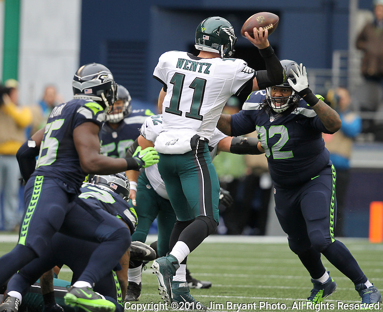Philadelphia Eagles quarterback Carson Wentz (11) passes under pressure from Seattle Seahawks defensive tackle John Jenkins (92) at CenturyLink Field in Seattle, Washington on November 20, 2016.  Seahawks beat the Eagles 26-15.  ©2016. Jim Bryant Photo. All Rights Reserved.
