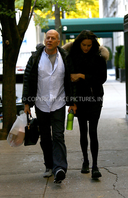 WWW.ACEPIXS.COM<br /> <br /> November 6 2013, New York City<br /> <br /> Actor Bruce Willis and his wife model Emma Heming walk on the Upper East Side on November 6 2013 in New York City<br /> <br /> By Line: Philip Vaughan/ACE Pictures<br /> <br /> ACE Pictures, Inc.<br /> tel: 646 769 0430<br /> Email: info@acepixs.com<br /> www.acepixs.com