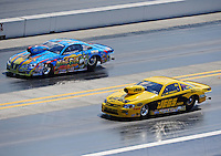 Sept. 17, 2010; Concord, NC, USA; NHRA pro stock drivers Greg Stanfield (left) races alongside Jeg Coughlin during qualifying for the O'Reilly Auto Parts NHRA Nationals at zMax Dragway. Mandatory Credit: Mark J. Rebilas/