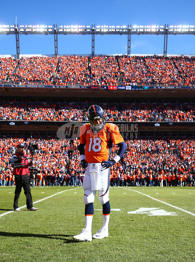 Jan 24, 2016; Denver, CO, USA; Denver Broncos quarterback Peyton Manning (18) reacts against the New England Patriots in the AFC Championship football game at Sports Authority Field at Mile High. The Broncos defeated the Patriots 20-18 to advance to the Super Bowl. Mandatory Credit: Mark J. Rebilas-USA TODAY Sports