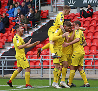 Fleetwood Town's James Wallace is mobbed after scoring his side's second goal <br /> <br /> Photographer David Shipman/CameraSport<br /> <br /> The EFL Sky Bet League One - Doncaster Rovers v Fleetwood Town - Saturday 6th October 2018 - Keepmoat Stadium - Doncaster<br /> <br /> World Copyright © 2018 CameraSport. All rights reserved. 43 Linden Ave. Countesthorpe. Leicester. England. LE8 5PG - Tel: +44 (0) 116 277 4147 - admin@camerasport.com - www.camerasport.com