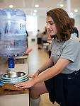 "NAUGATUCK, CT- 20 May 2016-052016EC02-  Angelina Gregory, a student at St. Francis – St. Hedwig School in Naugatuck, demonstrates her invention, the ""Jug A Dog."" The fifth grader thought of the idea for families who go away for days at a time and leave their pet home. The dog puts its paw on a wooden lever to the left and refills water from the upside down jug. There were 38 total inventions from fourth and fifth graders Friday. The students started working on the projects in February. Their goal was to solve problems they saw in their community. Erin Covey Republican-American"