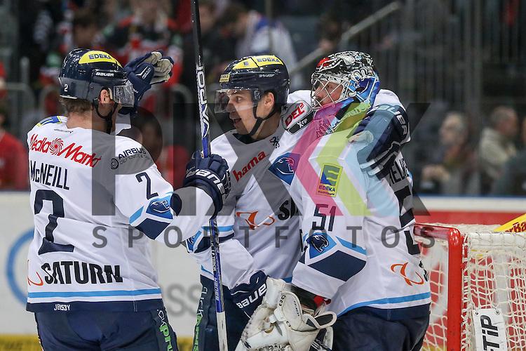 Jubel ueber den Sieg, Ingolstadts Benedikt Kohl (Nr.34) und Ingolstadts Timo Pielmeier (Nr.51) mit Ingolstadts Patrick McNeill (Nr.2)  beim Spiel in der DEL, Koelner Haie - ERC Ingolstadt.<br /> <br /> Foto &copy; PIX-Sportfotos *** Foto ist honorarpflichtig! *** Auf Anfrage in hoeherer Qualitaet/Aufloesung. Belegexemplar erbeten. Veroeffentlichung ausschliesslich fuer journalistisch-publizistische Zwecke. For editorial use only.