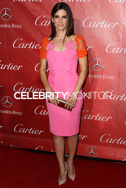 PALM SPRINGS, CA - JANUARY 04: Actress Sandra Bullock wearing a sherbert colored Alex Perry sheath with floral embellishments arrives at the 25th Annual Palm Springs International Film Festival Awards Gala held at Palm Springs Convention Center on January 4, 2014 in Palm Springs, California. (Photo by Xavier Collin/Celebrity Monitor)