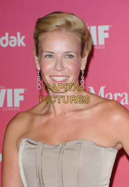 CHELSEA HANDLER .at The Women in Film 2009 Crystal .and Lucy Awards held at The Hyatt Regency Century Plaza in Century City, California, USA, June 12th 2009                                                                     .portrait headshot strapless silver dangly earrings beige .CAP/DVS.©DVS/RockinExposures/Capital Pictures